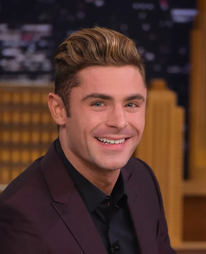 Zac Efron s Hair Has Reached Peak Surf Brah   GQ NEW YORK  NY   MAY 18  Zac Efron Visits  quot The Tonight Show