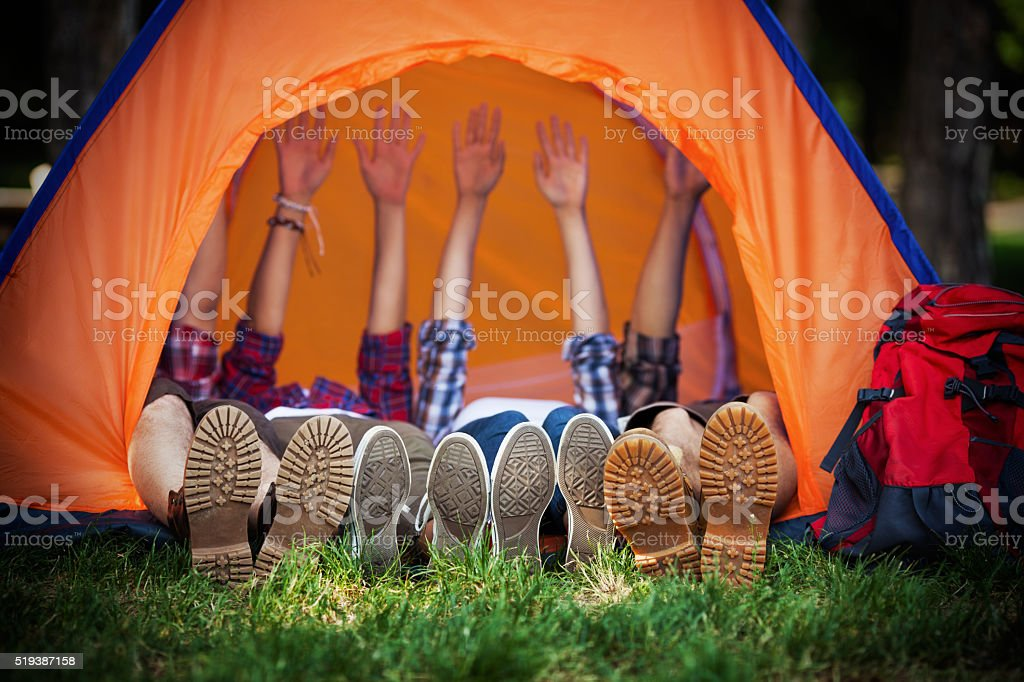 Royalty Free Camping Pictures  Images and Stock Photos   iStock Happy Campers Lying in a Tent stock photo