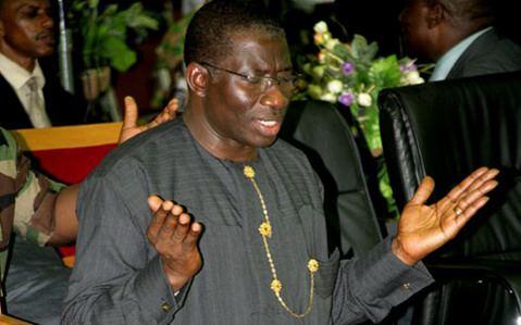 President Goodluck Jonathan in prayers