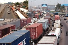 A-long-queue-of-tankers-on-Apapa-Oshodi-Expressway.-Inset-Articulated-vehicles-parked-at-Westminster-Bus-Stop-Apapa-360x240