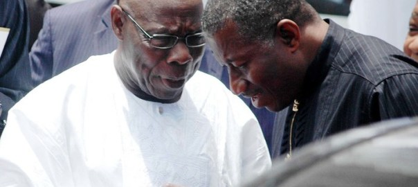 Former President Olusegun Obasanjo whispering to  Goodluck Jonathan, a former president too while latter was still in power