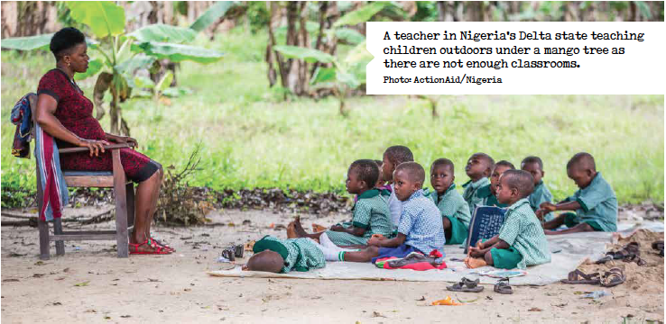 A teacher in Nigeria's Delta state teaching children outdoors under a mango tree as there are not enough classrooms. Photo: ActionAid/Nigeria
