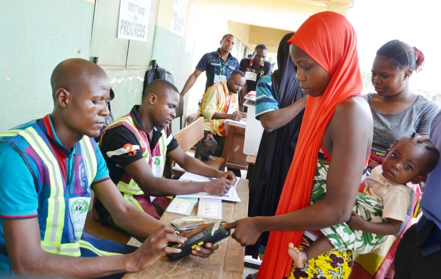 PIC.18. A VOTER, MRS JUMIMMA ABUBAKAR, BEING VERIFIED  BY INEC   AD-HOC STAFF AT THE SHADA GALADIMA POLLING UNIT KWALI, DURING THE   2016 FCT AREA COUNCIL ELECTIONS ON SATURDAY (9/4/16). 2833/9/4/2016/EO/CH/NAN