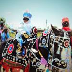 A young boy riding on a horse at the Bauchi Sallah Durbar