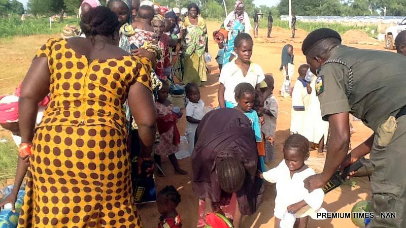 PIC.1. AN OFFICIAL OF THE POLICE ANTI-BOMB SQUAD CHECKING SOME OF THE INTERNALLY DISPLACED PERSONS (IDPs) EVACUATED FROM MUBI TRANSIT CAMP TO MALKOHI CAMP IN YOLA BY ADAMAWA STATE GOVERNMENT ON SATURDAY (24/9/16). ABOUT 350 IDPs, MOSTLY WOMEN AND CHILDREN WERE THUS EVACUATED.  7066/AMA/BJO/NAN