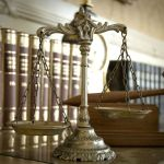 Symbol of law and justice, law and justice concept, focus on the scales