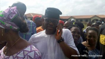 Eyitayo Jegede queuing to vote at his polling unit