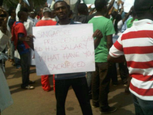 A protester at Transcorp Hilton Junction, Abuja