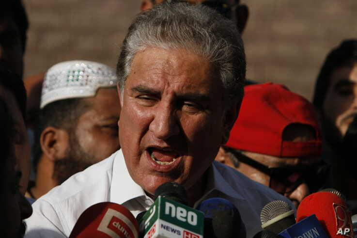 In this Friday Oct. 11, 2019 photo, Pakistan's Foreign Minister Shah Mahmood Qureshi speaks to reporters in Multan, Pakistan…