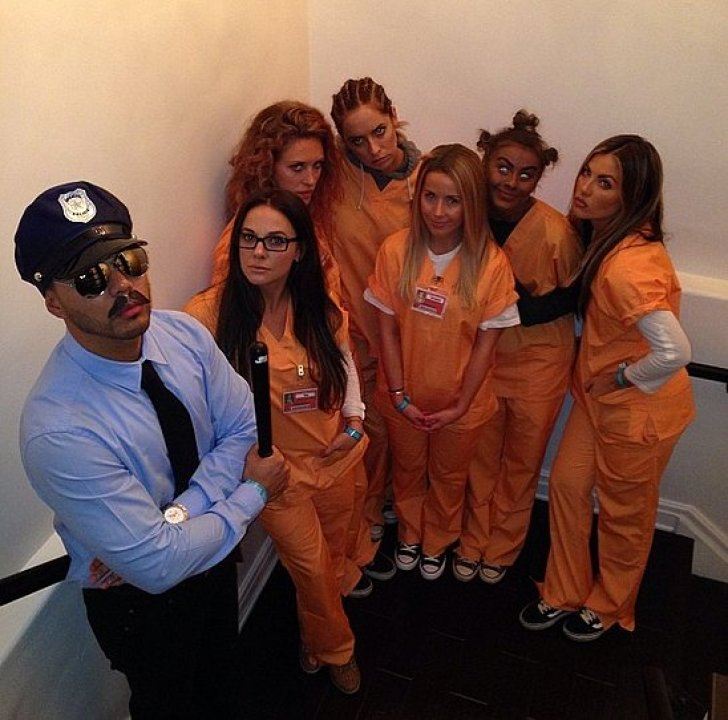 Derek Hough shared a snap of his sister, Julianne Hough, with a group dressed up as the characters from Orange Is the New Black. The photo has since been taken down, and Julianne apologized via Twitter for her controversial costume choice.<br /><br /> Source: Instagram user derekhough<br /><br />