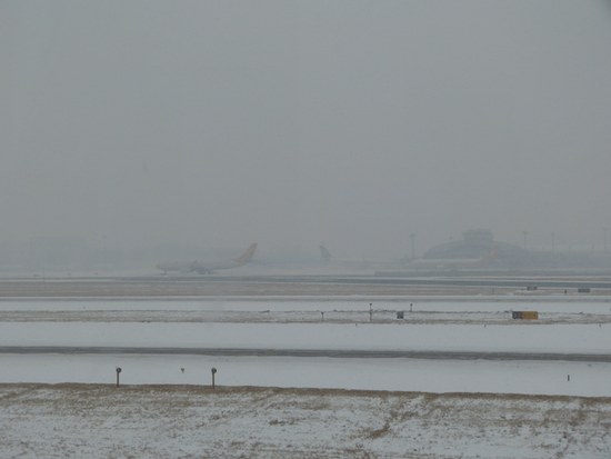 Snowing at Beijing airport