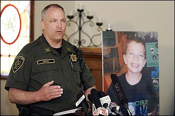 Capt. Jason Gates of the Multnomah County Sheriff's office talks   to reporters as he stands next to a photo of missing 7-year-old Kyron   Horman, at a church across from Skyline Elementary School in Portland,   Ore., Monday June 7, 2010. A widening search for the child who   disappeared from his school entered a fourth day Monday, with sheriff's   deputies stopping motorists in the hunt for clues and distributing   fliers bearing the picture of the spectacled boy. (AP Photo/Greg   Wahl-Stephens)