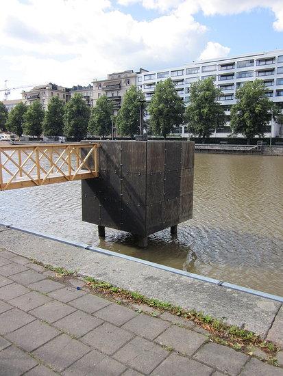 Cube sauna in the river