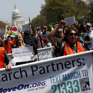 Image: Tax Day demonstrators march away from the U.S. Capitol on April 15, 2017 in Washington, DC. Activists gathered in cities nationwide to demand President Donald Trump release his tax returns.