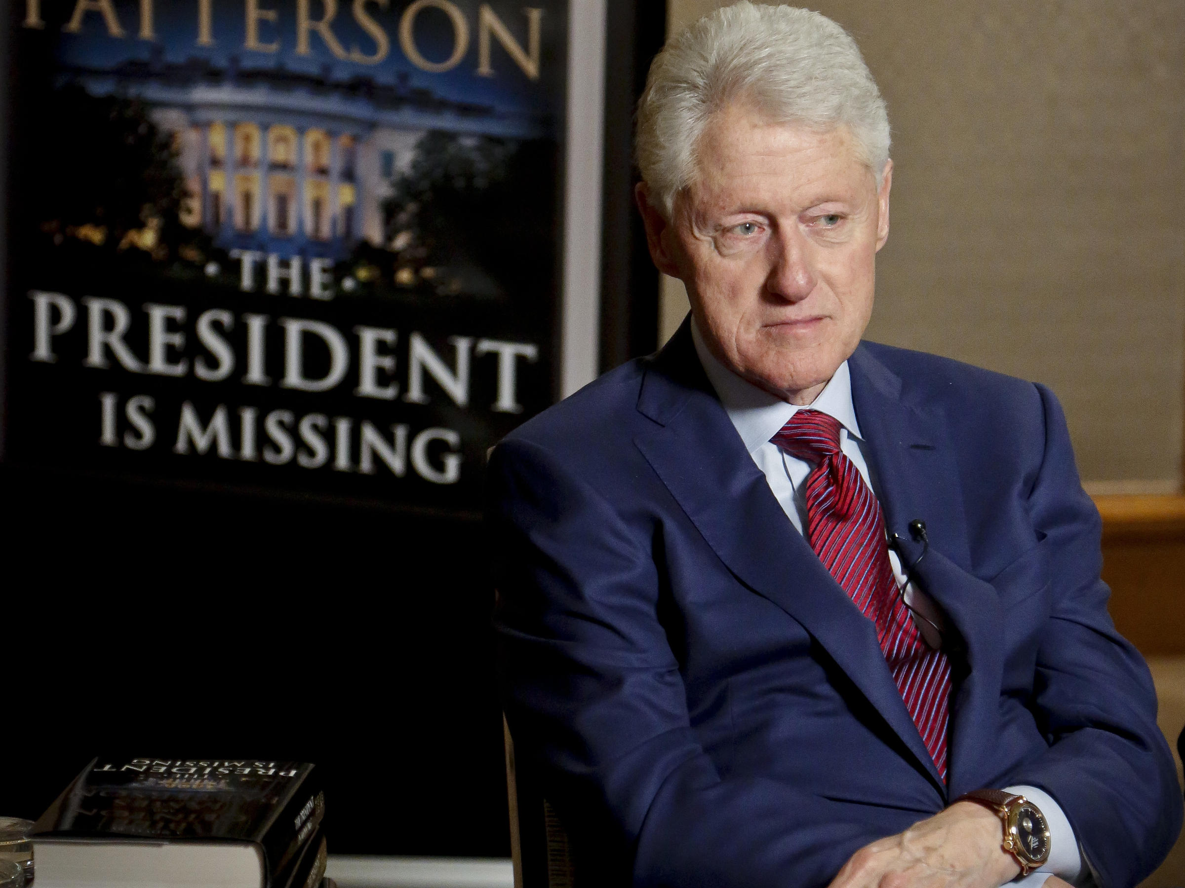 In Bill Clinton s New Thriller  A  Fictional  President Faces     Former President Bill Clinton listens during a Monday interview about The  President is Missing  a novel he wrote with James Patterson
