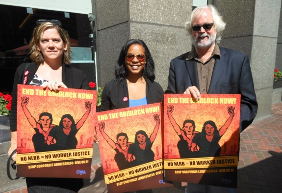 """CWA and Pacific Media Workers Guild staffers, Sara Steffens and Autumn Grace join SF Labor Council Executive Director Tim Paulson at a labor action in San Francisco.  The End the Gridlock Now"""" posters were designed and printed by Guild union shop Design Action Collective."""