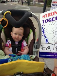 Emmalyn Spencer was the youngest participant in the Monday street action at Purple's offices in Denver.