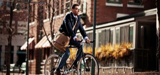 businessman-commuting-to-work-on-bike_h