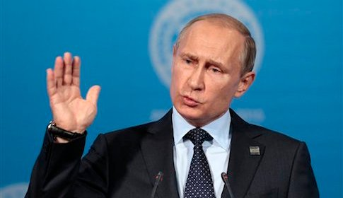Russian President Vladimir Putin gestures while speaking at a news conference after the Shanghai Cooperation Organization (SCO) summit in Ufa, Russia, Friday, July 10, 2015.  President Vladimir Putin announced Friday that India and Pakistan will join the Shanghai Cooperation Organization, a group dominated by Russia and China and also including former Soviet republics in Central Asia. (AP Photo/Ivan Sekretarev)