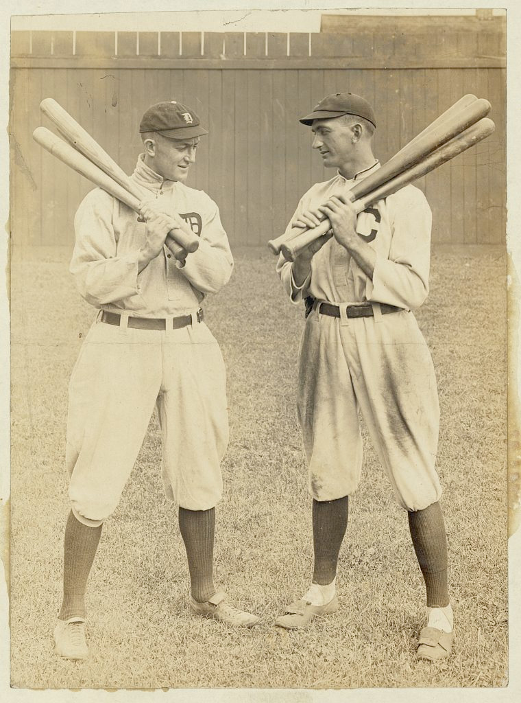 Ty Cobb, Detroit, and Joe Jackson, Cleveland, standing alongside each other, each holding bats