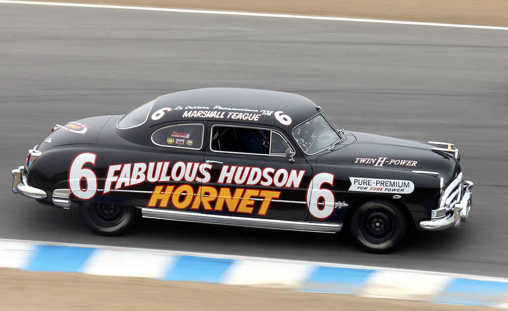 1951 Hudson Hornet racing in Group 3B (1947-1955 Sport Racing & GT Cars over 2500cc) at the 2010 Rolex Monterey Motorsports Reunion :: Photo By Adam Swank