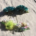 I made these decorated flower hair clips. They have metal hair clips on the backs. $5 each - Send me a message via the contact page to get my PayPal info for purchase, with the item name and which clip you'd like to purchase.