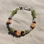 "Small ~6"" bracelet on nylon-coated wire string, wire clasps and various gemstone beads including citrine, moonstone, garnet, and peridot.  $7.50 - Send me a message via the contact page to get my PayPal info for purchase."