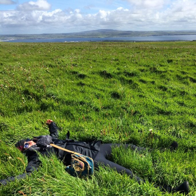 "<font size=""5""> Laying in the greenest, softest grass in the world at the top of the Cliffs of Moher in County Clare, Ireland.</font>"