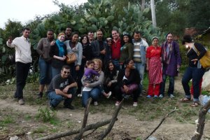 A group of study abroad students in rural Morocco, posing with a family that they have just spent three hours visiting. After a frank and earnest conversation about life in rural Morocco and the students' diversity of experiences in America, sharing a meal together prepared by students and the family, and a bit of cultural exchange through sharing music and dance, this picture serves as a way to remember the experiences of the afternoon and the personal connections with individuals.  (Photo courtesy of K. Rosenbaum)