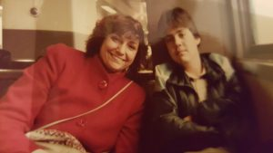 Mom and Rodrigo on the train for sightseeing in NYC, 1985.