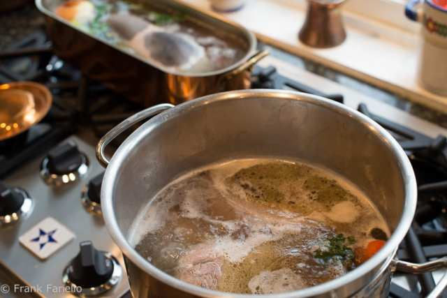 The primary meats boiling in the large pot, ox tongue simmering separately in the background.