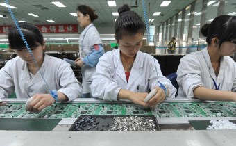 Chinese workers assembling circuit boards at a factory in Mianyang, southwest China's Sichuan province on April 30, 2012.  China's manufacturing activity rose in April to a 13-month high, official data showed, indicating the world's number two economy may have bottomed out in the second quarter.  CHINA OUT      AFP PHOTO        (Photo credit should read AFP/AFP/GettyImages)