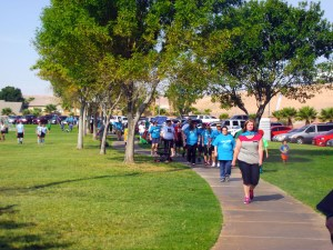Supporters of the 2015 Walk for Memory/Walk for Hope complete their first of 7 laps in their walk to raise awareness for suicide prevention.  This is the 4th annual walk held in Mesquite and sponsored by the Nevada Coalition for Suicide Prevention and the Mesquite Department of Athletics and Leisure Services. Photo by Teri Nehrenz.