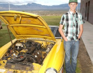 Nathan Cannon and his about-to-be-restored 1978 MGB roadster on display at the Virgin Valley High School Career and Technical Education and Arts Night on April 28. Photo by Burton Weast.