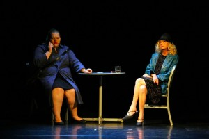 """Jean (Jenna Grubb) meets with 'Mystery Woman' (Joan Pelliccio) in a café in Dead Man's Cell Phone which has its final performances on May 20 and 21.  May 21 performance will not be censored; the show is rated """"R"""".  Photo by Teri Nehrenz"""