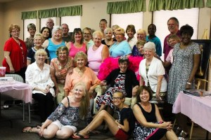 :  Mesquite Toes Tap Team members and supporters gather around the 'Queen of the Dance' during Vicki Eckman's retirement party at the Mesquite Lutheran Church on May 19.  Photo by Teri Nehrenz