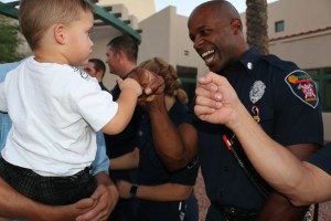 Children are warmly welcomed by Mesquite firefighters including Jason Blakely, right, to a September 11 commemoration ceremony held at City Hall. Photo by Barbara Ellestad.