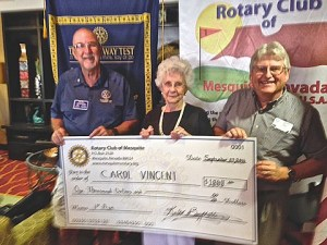 Rotary Assistant Governor Jake Noll presents Carol Vincent her check assisted by Jeff Bird who sold the winning ticket. Photo by Burton Weast