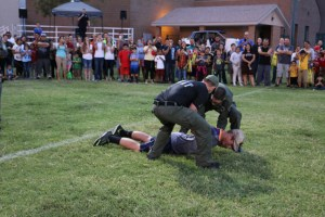"Virgin Valley High School Senior Reid Jensen volunteered to be tazed at this year's Mesquite Night Out on Sept. 21. Jensen was talked into it by his brother-in-law Quinn Averett, who is currently the Public Information Officer with Mesquite Police Department. Jensen said he volunteered because ""I thought it would be real cool to do it,"" he said. ""I couldn't really move."" Thankfully, the effects of the paralyzing tazor wore off before his performance at the football game two days later where he plays as a tight end. After high school, Jensen will depart for a two-year mission. Averett told the MLN that the amount of power in this instance was about 10,000 watts. ""The stun mimics the central nervous system, and while the person cannot move or talk, they can still think and breathe. We usually only have to use extreme force like this two to three times per year, which considering the amount of arrests and incidents, is very low."" Photo by Stephanie Clark."