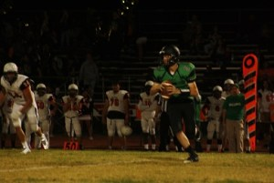 Bulldog quarterback Cade Anderson, making his first start for the injured Hogan Fowles, rolls to the left on a passing attempt during the Dawgs big win over Chaparral High School Friday night in the Dawg Pound. The win gave the Dawgs the 3A Sunrise League title. Photo by Lou Martin