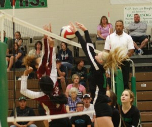Bulldog Emma Barnum goes up to block a Dragons shot during the Dawgs 3-0 sweep of Del Sol Wednesday Oct.5 in the Dawg House. Photo by Lou Martin
