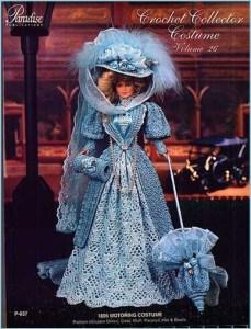 Кукла в вязаной одежде и с зонтиком