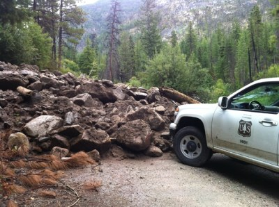 Last week's rains caused a major rock flow that blocked West Chewuch Road near Andrews Creek, gouging out sections of pavement. The obstruction was cleared on Friday. Photo courtesy of U.S. Forest Service