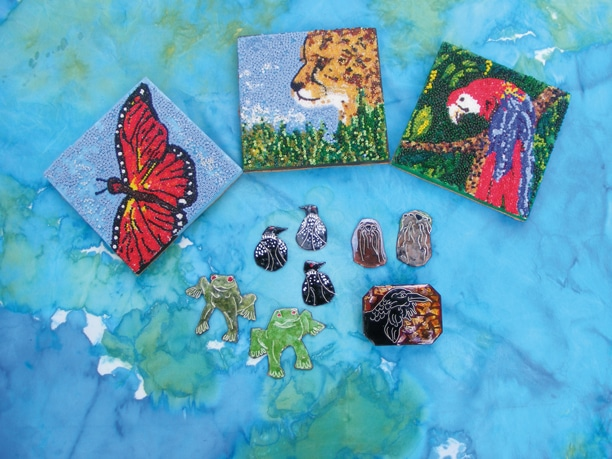 This is a selection of enamel and beadwork pieces by Gloria Spiwak.