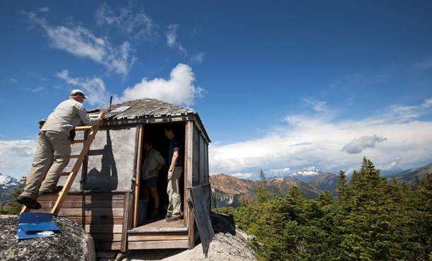 Dave Tucker of Bellingham inspects the dilapidated roof of Mebee lookout as renovation gets underway. Photo courtesy of John Scurlock