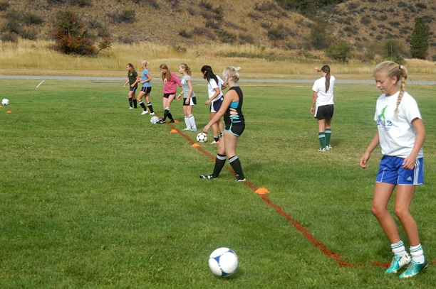 Freshman veteran Lauren Fitzmaurice works on her passing during a drill at soccer practice last week. Photo by Mike Maltais