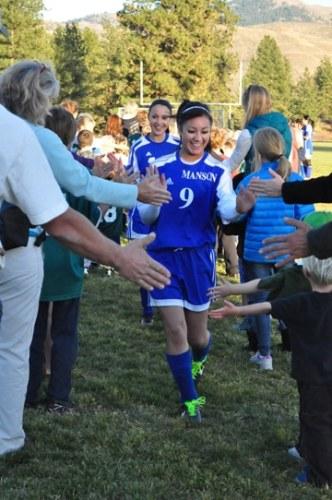 Soccer players slap their way through the receiving line Thursday evening.