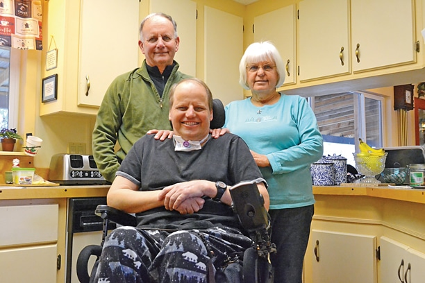 Andy Johnson, in wheelchair, is adapting to life at home in Twisp with his parents, Don and Karen Johnson. Photo by Laurelle Walsh