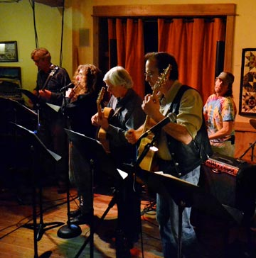 All that jazz.  Musicians from the Pipestone Jazz Ensemble, Frank Vander  Wall, left, Marcy Stamper, Terry Hunt, Alan Fahnestock and Richard Wasson regaled the post-game crowd with an assortment of jazz works at the Twisp River Pub on Sunday.  Photo by Laurelle Walsh