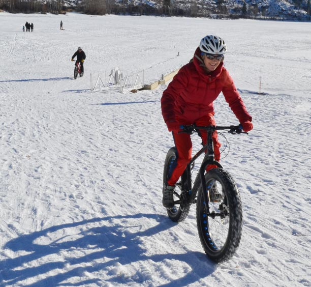 Holly English of Ellensburg, trailed here by husband, Jim Repsher, was among the 50 adventurous souls who tried fat biking for the first time on Saturday. Photo by Laurelle Walsh
